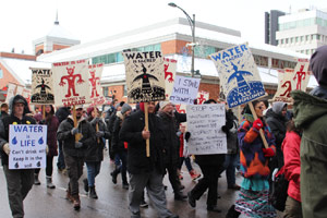 """Our world is falling apart"": Local protesters march against pipeline, RCMP photos"